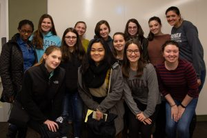 Women Engineers of Rowan University grouped together at group meeting.