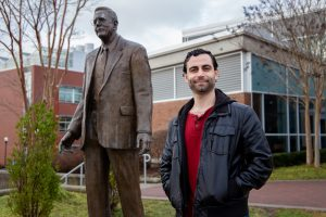 Dave next to Mr. Rowan statue outside Savitz