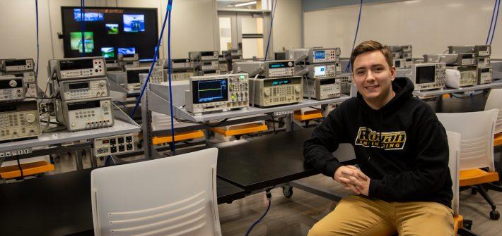 DJ sitting inside electrical lab