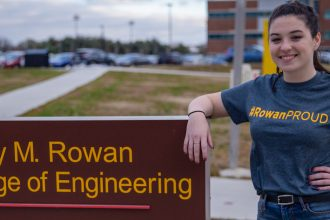 Kelly outside Rowan College of Engineering sign outside