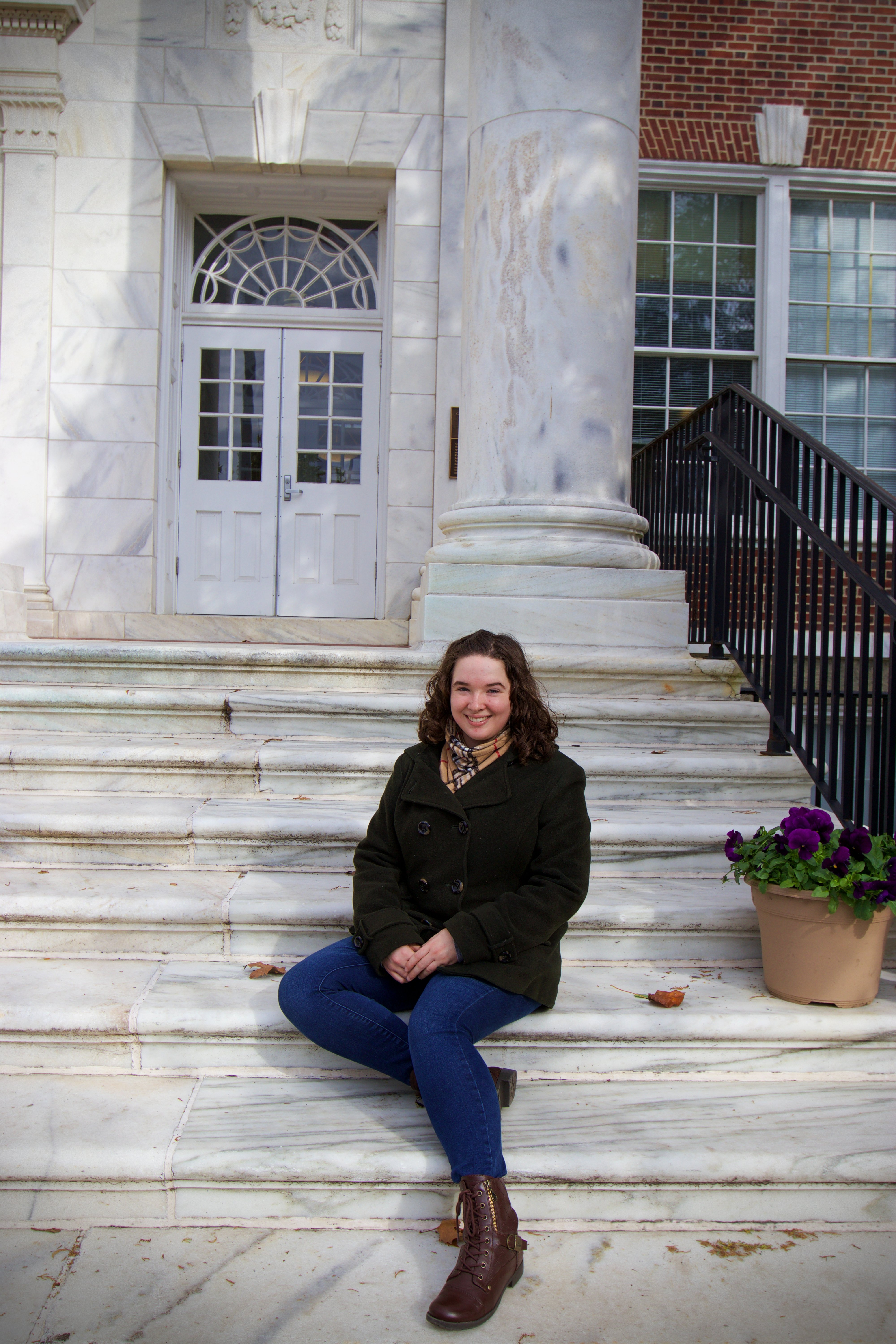 Elizabeth sitting on the front steps of Bunce Hall.