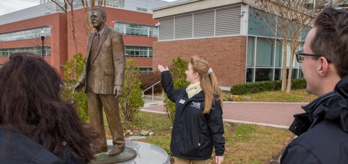 Grace gives new students a tour of Rowan starting with the Henry Rowan Statue