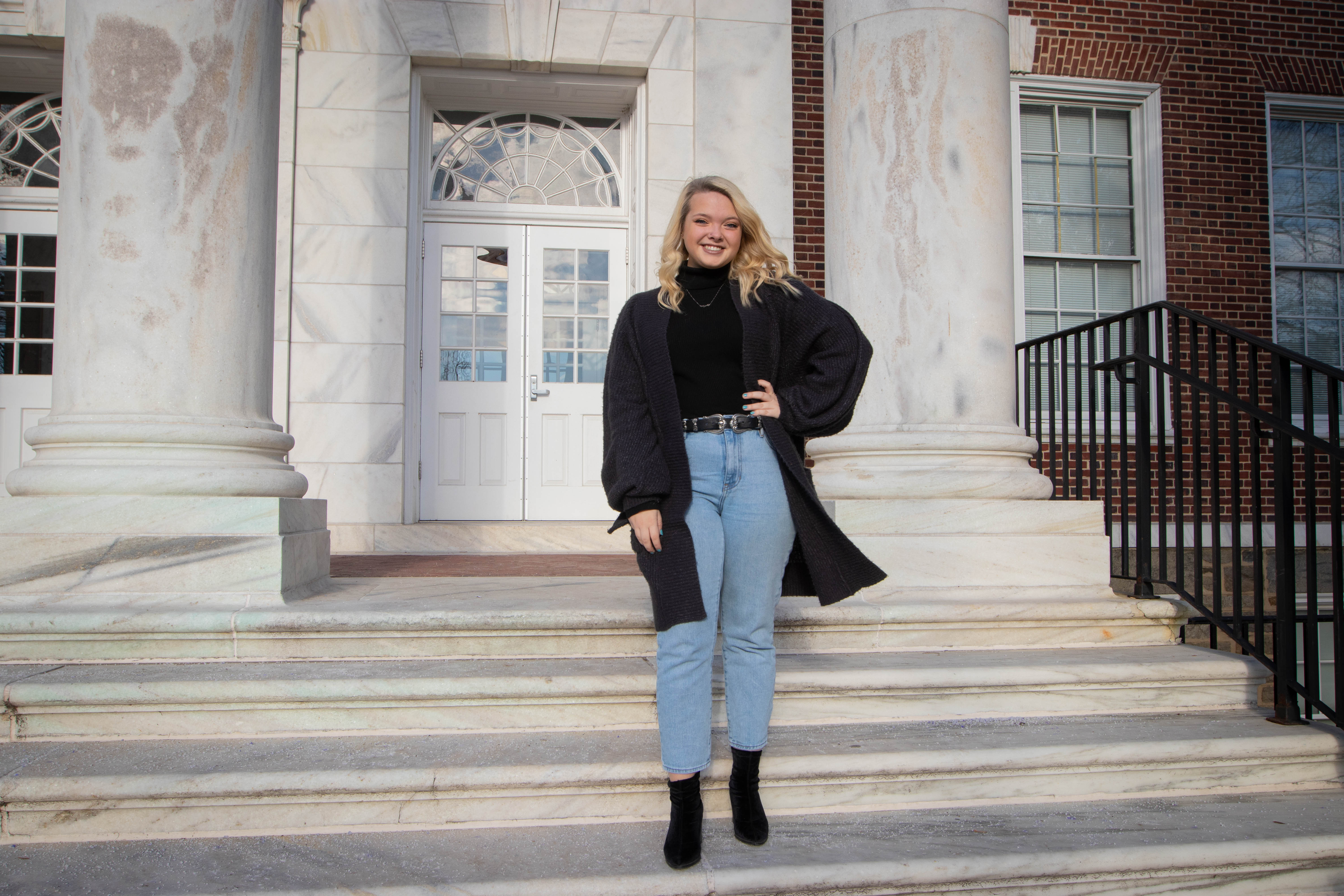 Molly Moore posing in front of Bunce Hall.