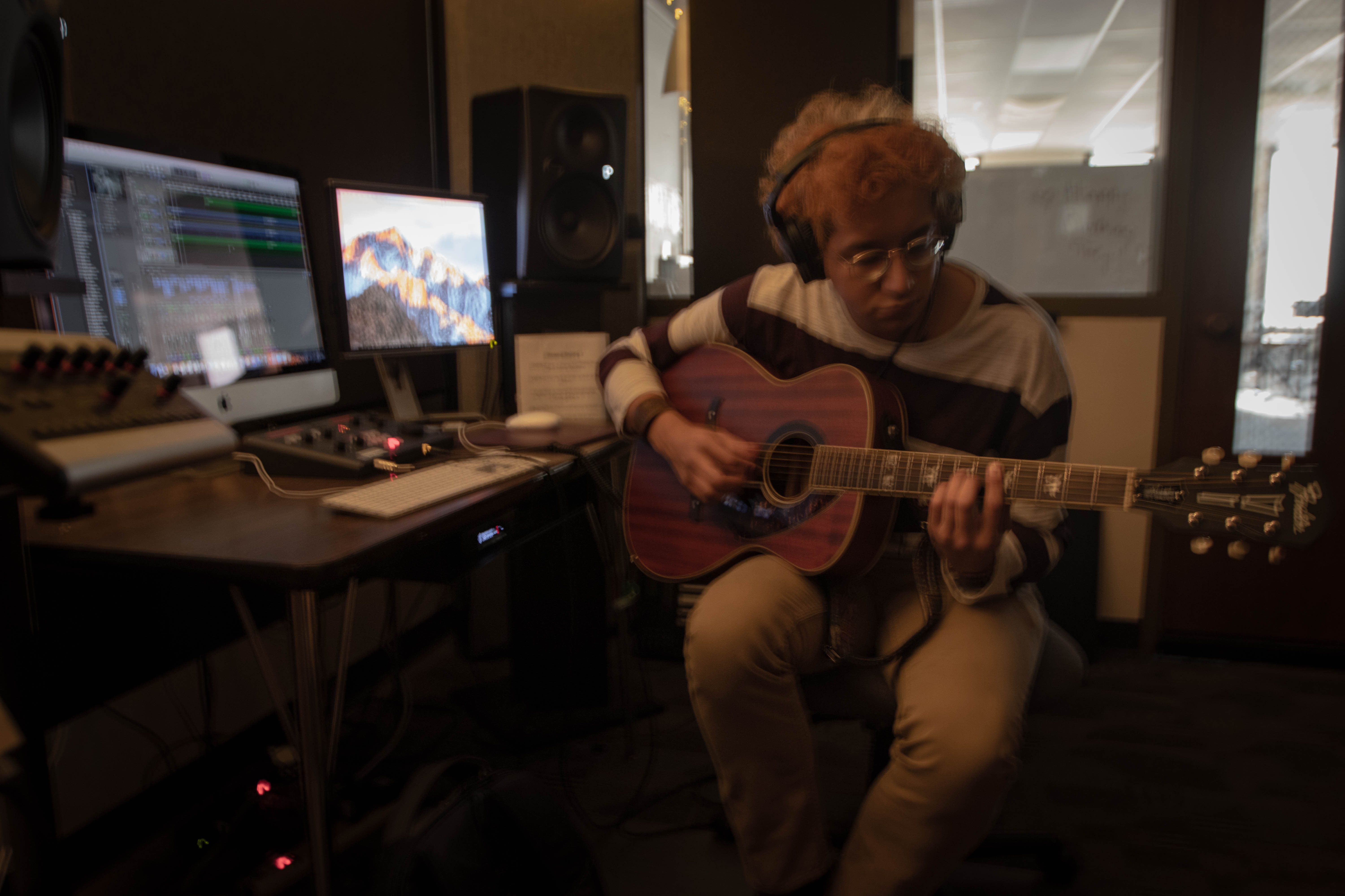 Luis playing the guitar in one of Wilson Halls studios.