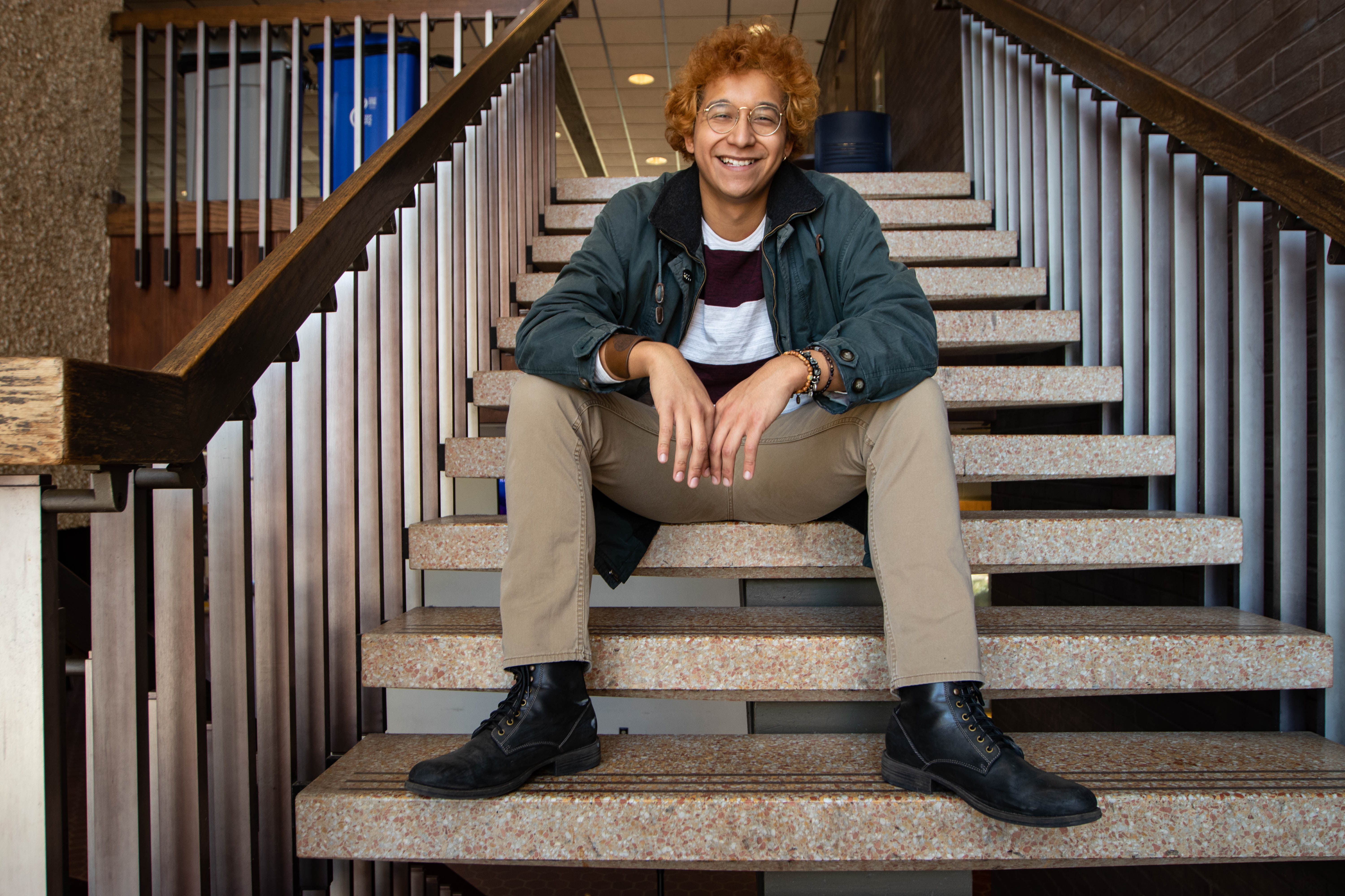 Luis posing on the steps on Wilson Hall.