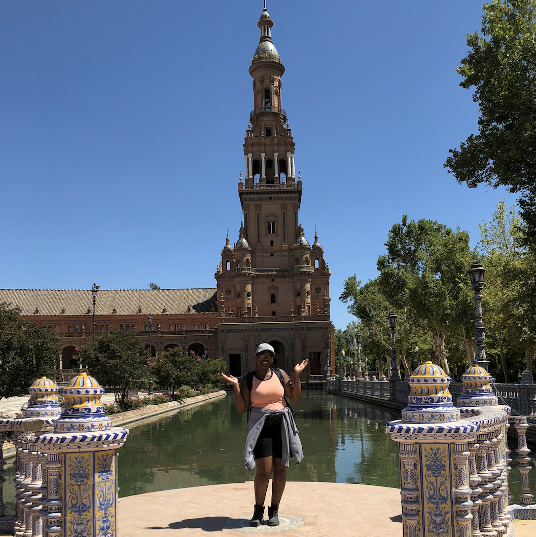 Amber posing in front of a Spanish landmark.