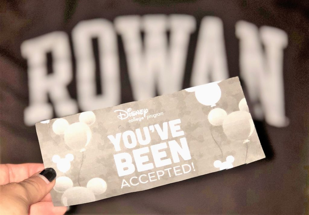 A Rowan tshirt next to the acceptance letter for the disney college program