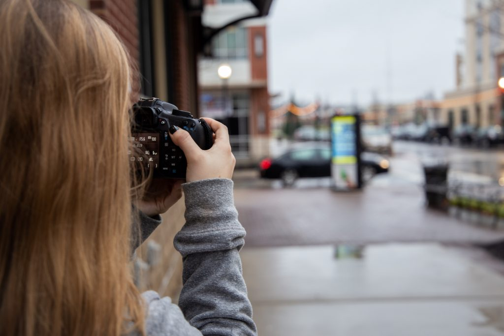 Kailey with camera on the Rowan Blvd.