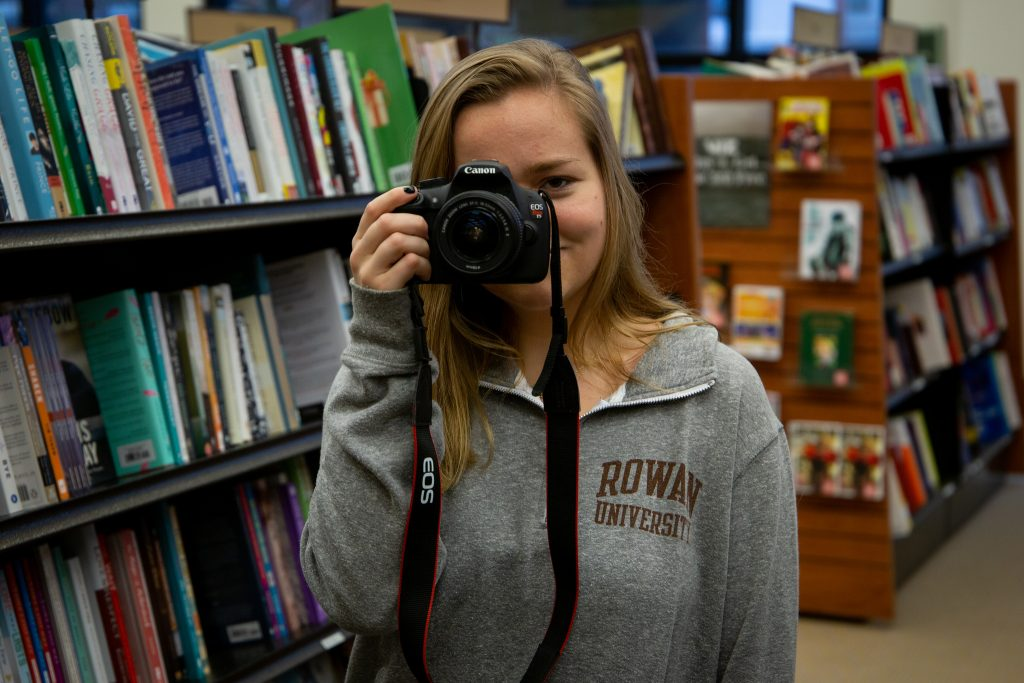 Kailey holding camera inside barnes and nobles inside book store