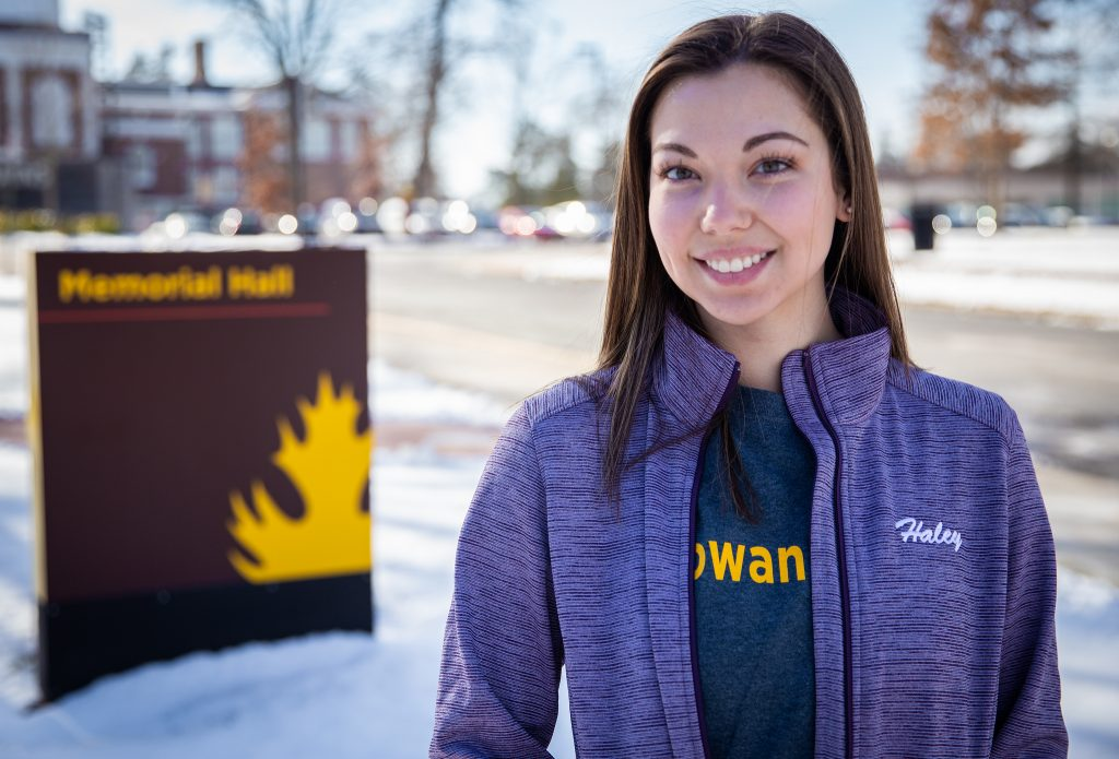 Haley in #ROWANproud shirt outside Memorial Hall in hoodie that days Haley on front