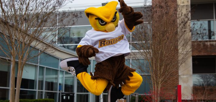 Rowan mascot jumps for joy outside of Savitz Hall at Rowan University
