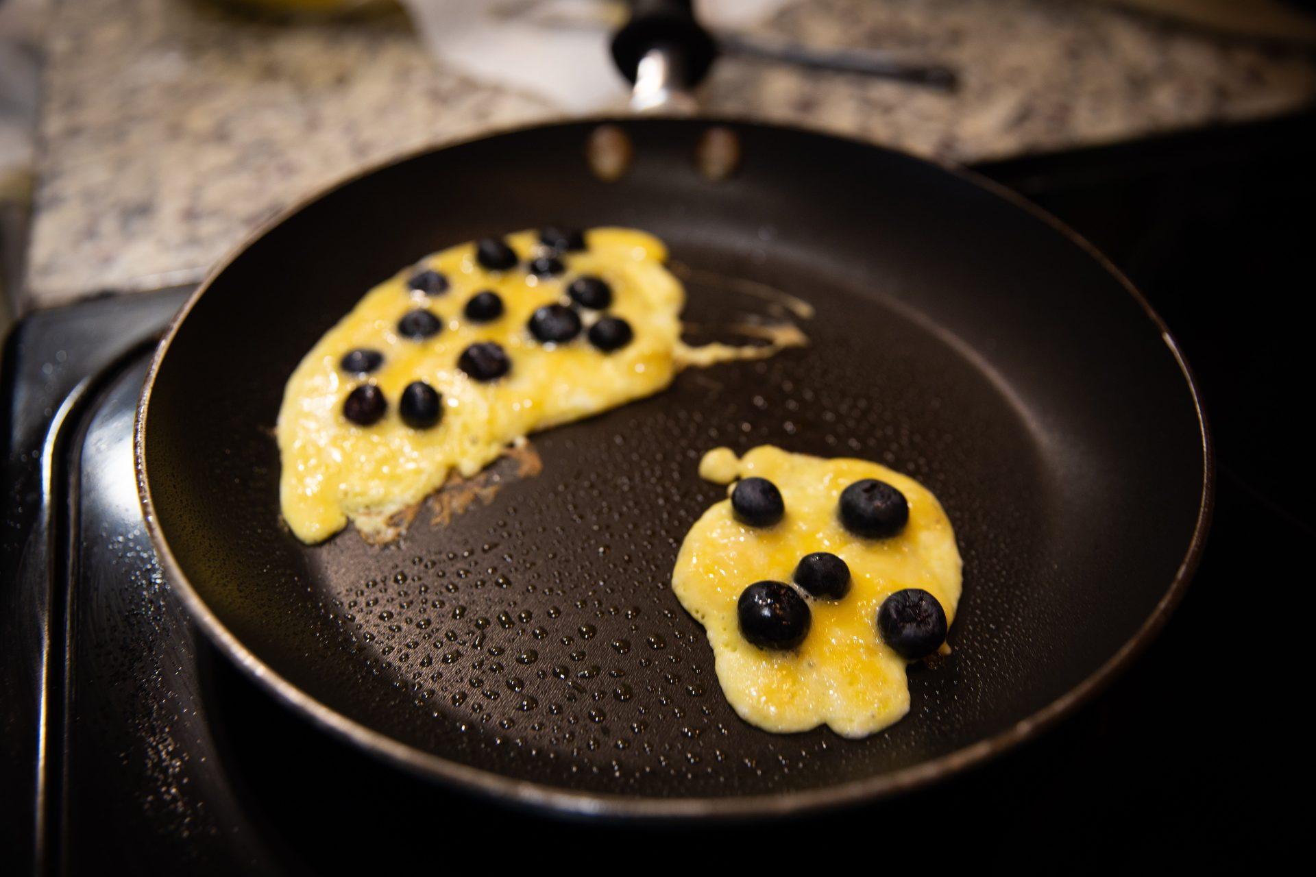 Cooking pancakes.