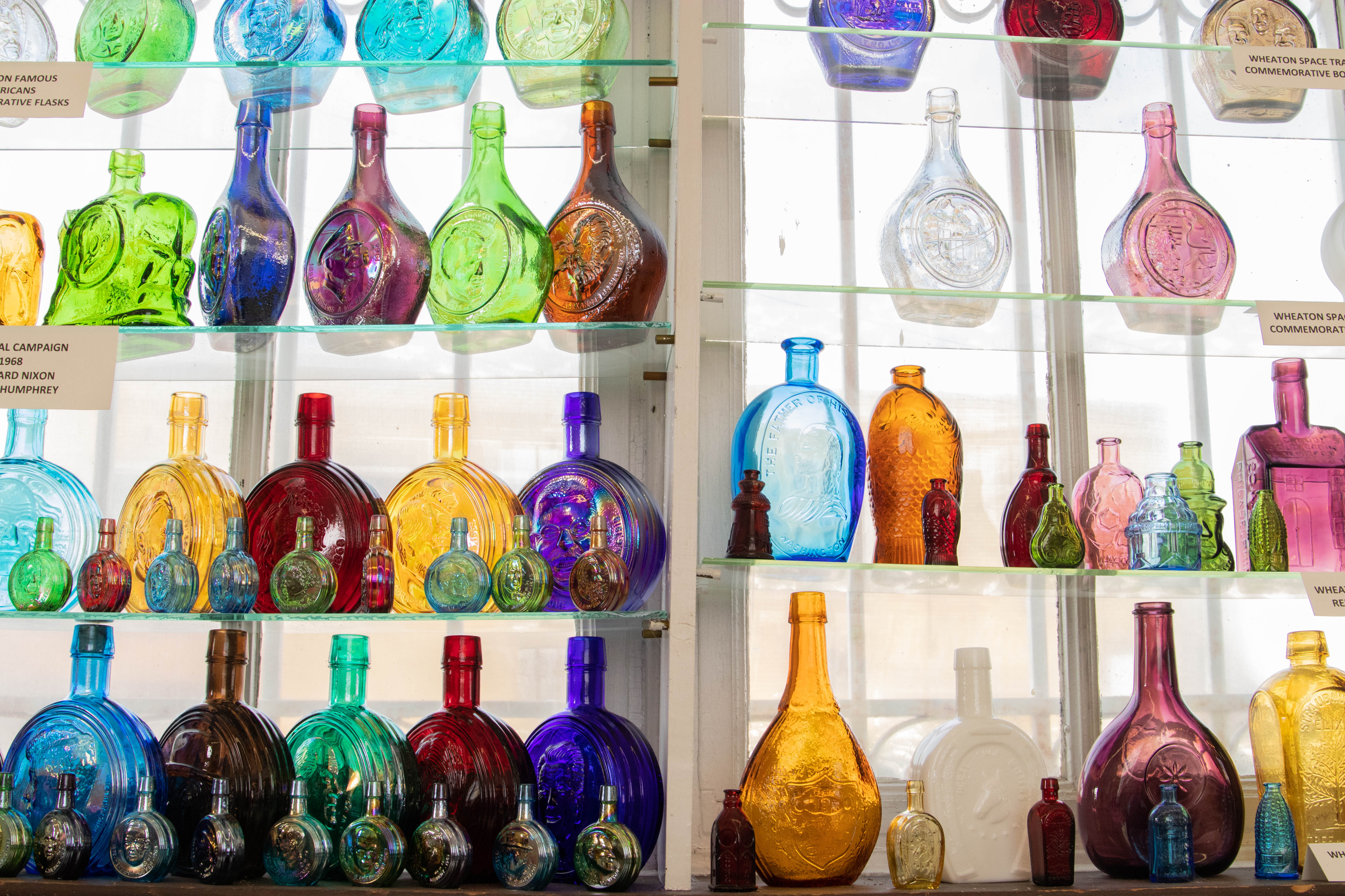 Display of antique glass pieces.