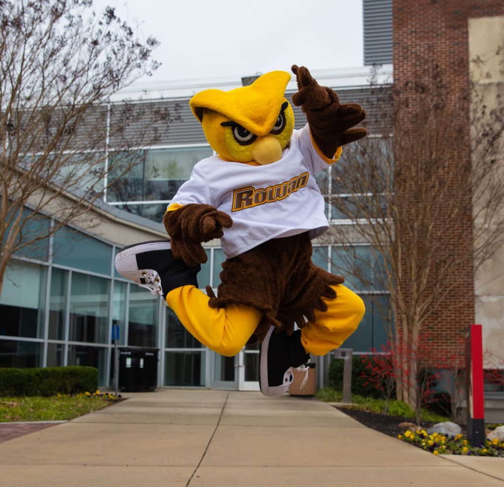 Mascot Whoo RU jumps for joy outside of Savitz Hall