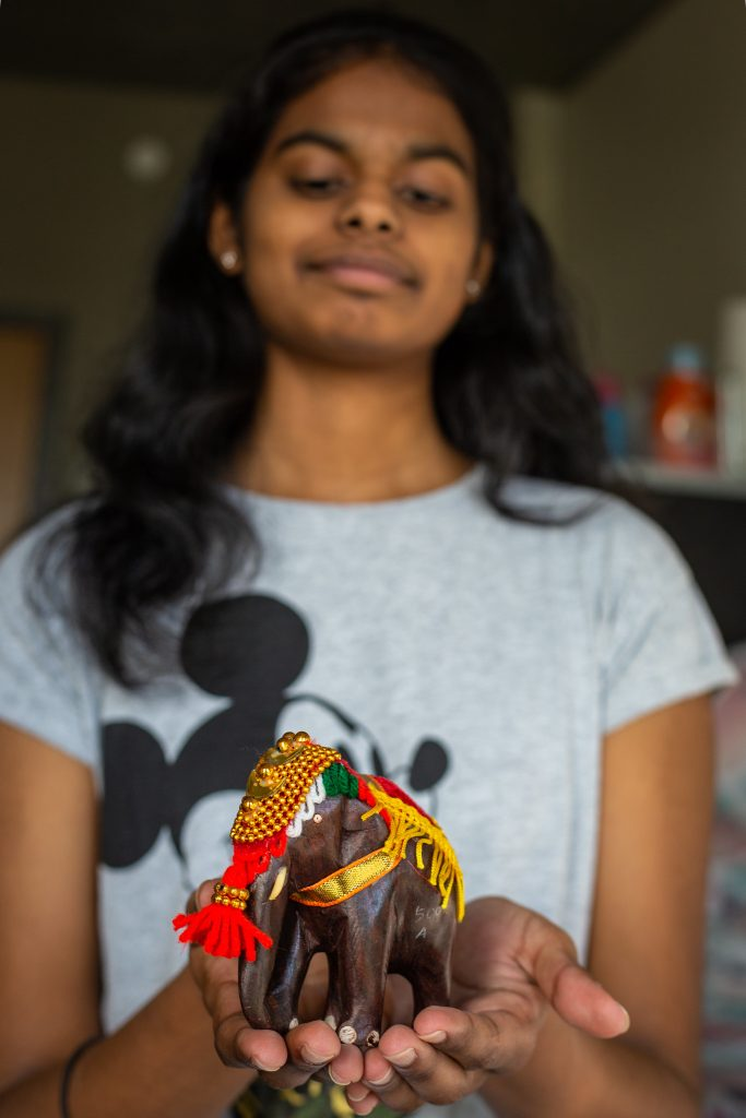 Prasheetha holding an elephant collectible from India from her mom