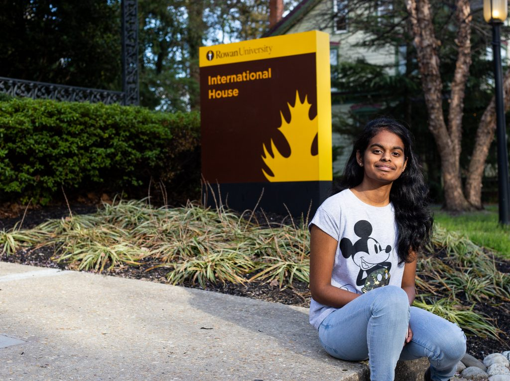 Prasheetha sitting out front of the International House