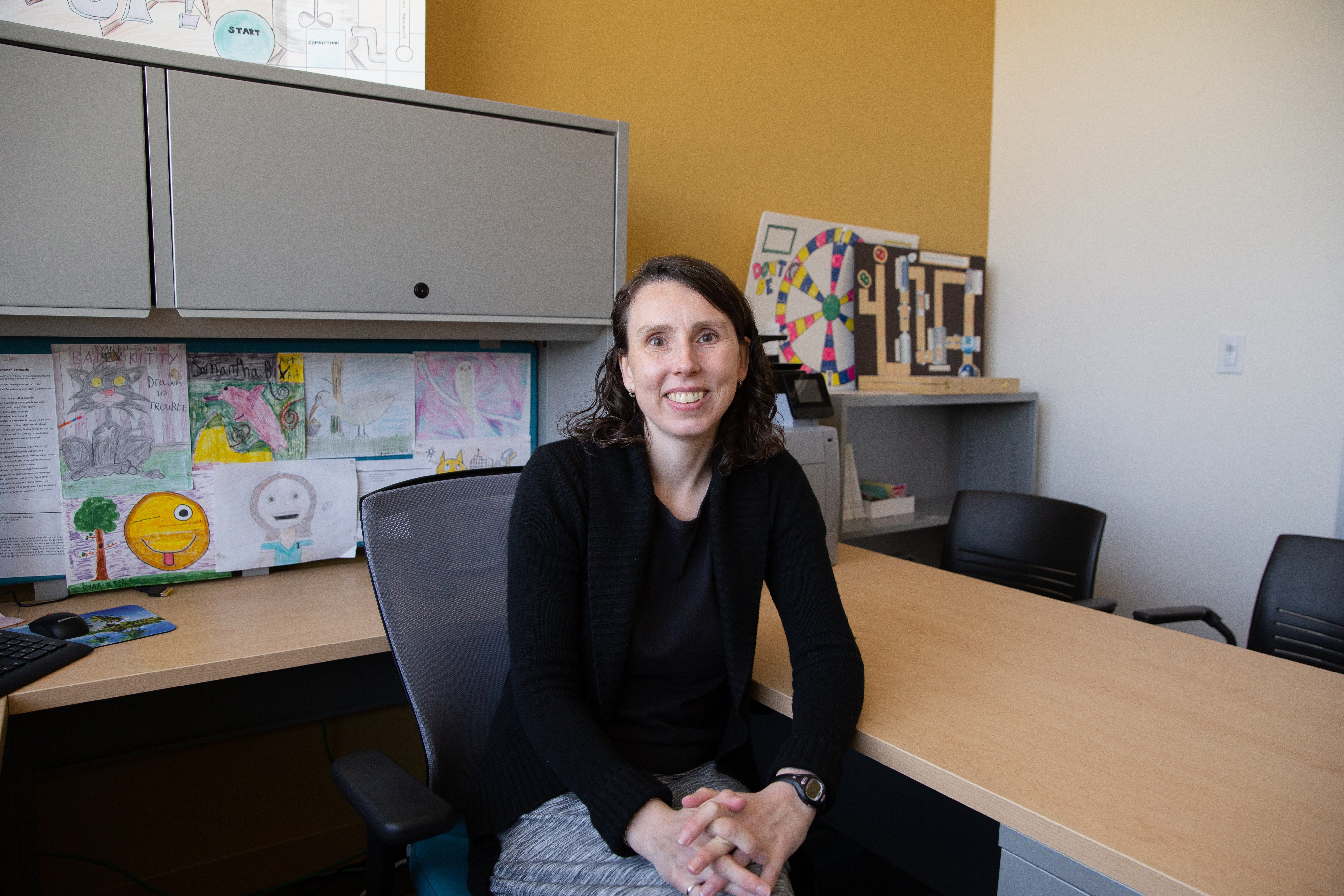 A portrait of Dr. Bodnar at her desk located in the engineering building.