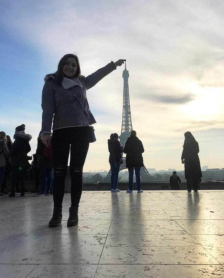 "Brianna ""touching"" the top of the Eiffel Tower in Paris, France during her winter abroad trip in 2017."