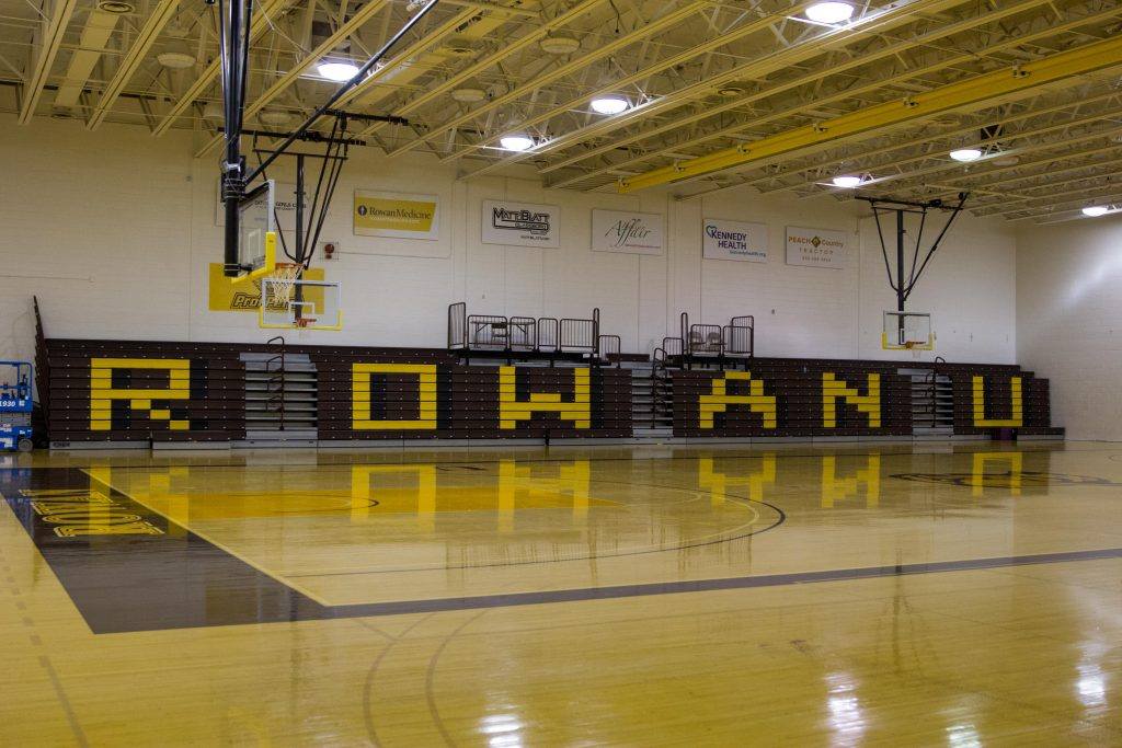 Rowan U is shown printed on the folded bleachers at the basketball court