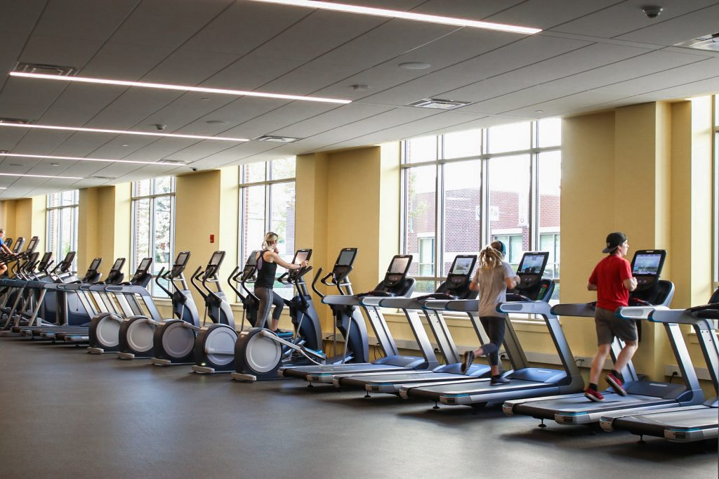 Students are running on the treadmill at the Rowan Fitness Center.