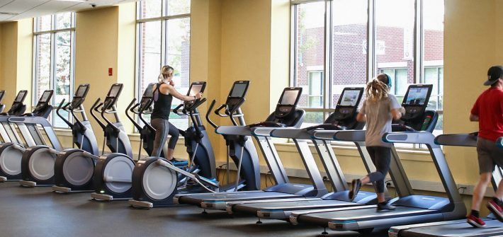 Several students working out on treadmills in a fitness center
