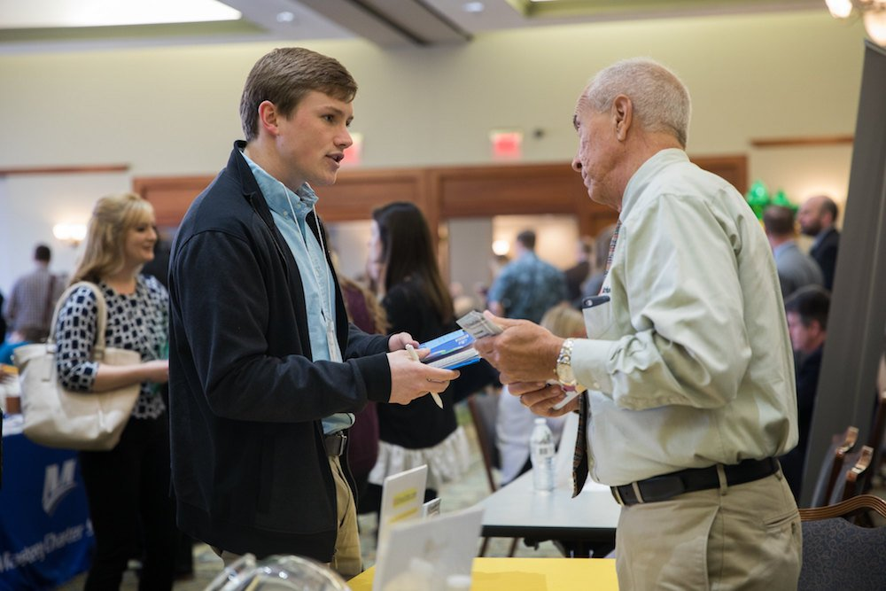A student at a career fair talking to an employer
