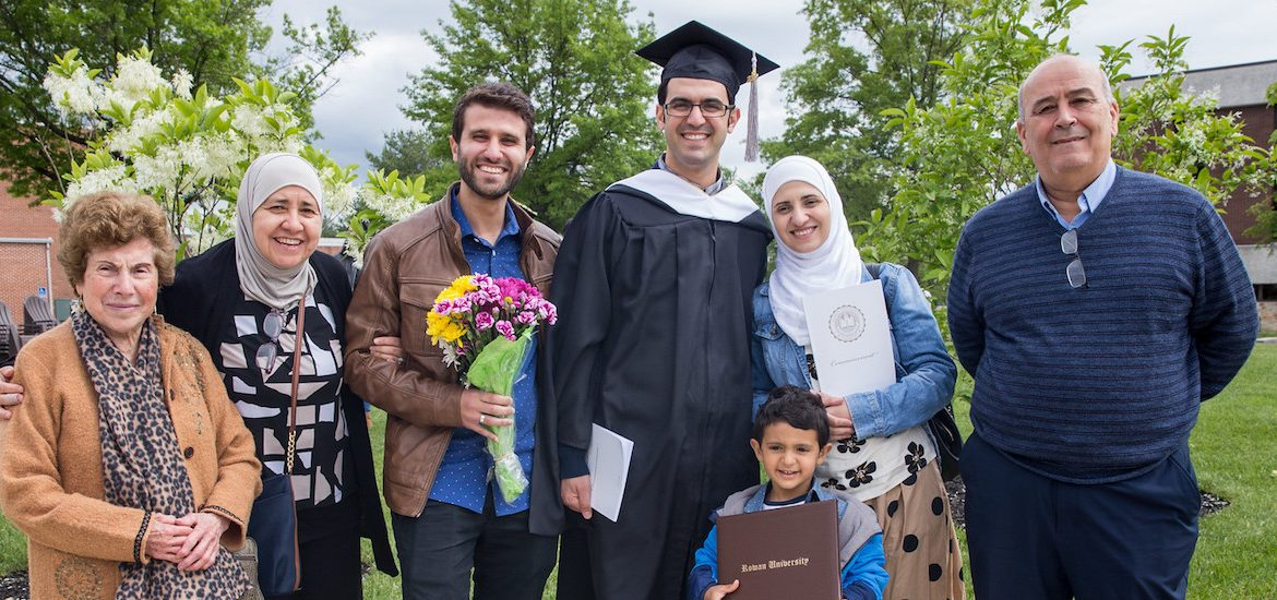 Ahmad Kindawi stands with his family at Rowan University graduation