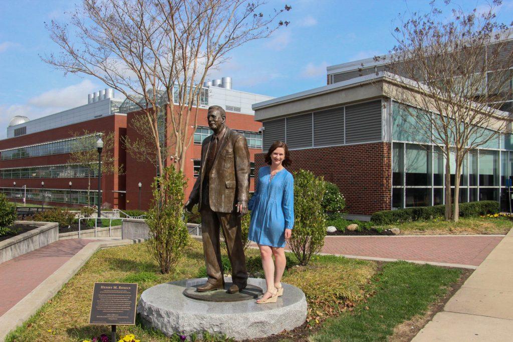 Amanda standing next to the Henry Rowan Statue outside Savitz Hall