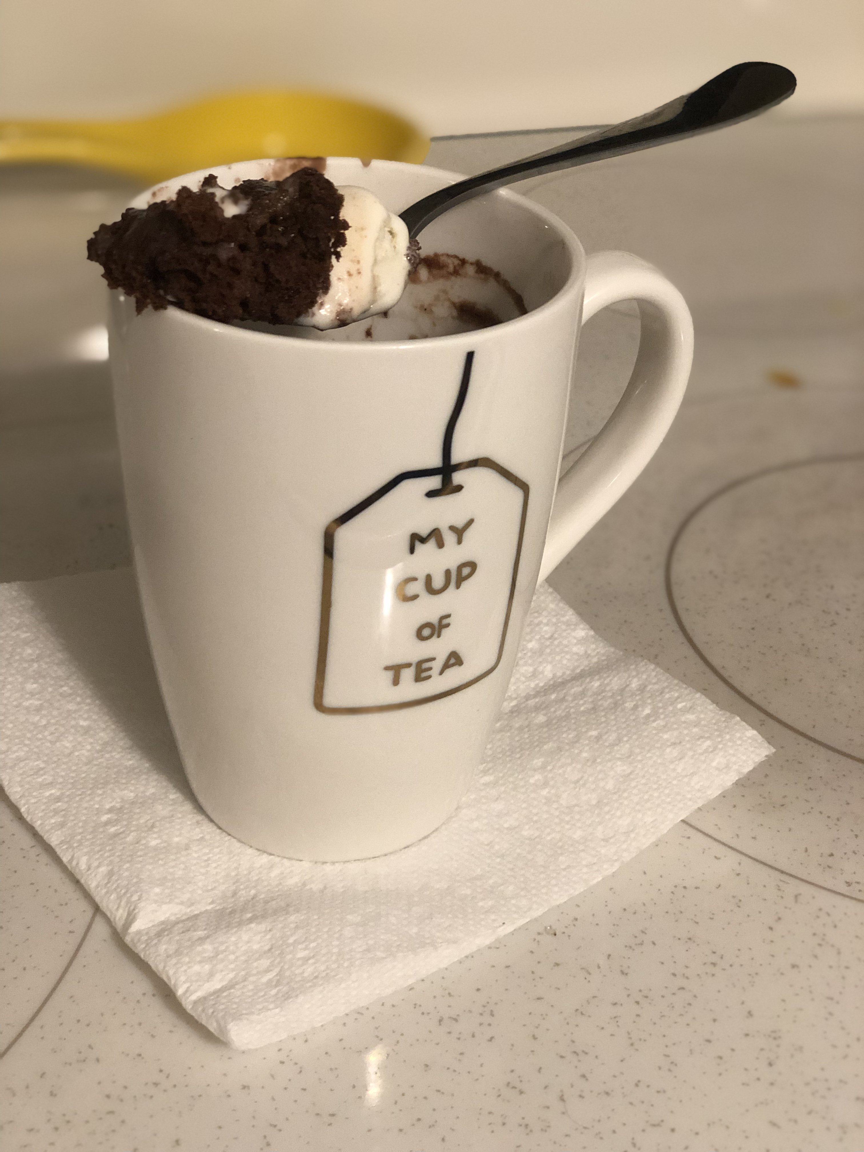 the finished dessert - chocolate and whip cream poking out of the mug