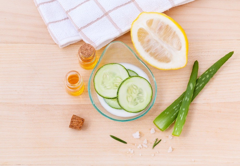A close up of a cucumber, aloe and lemon face mask