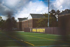 Rowan University sign on the soccer field.