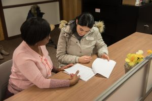 A Rowan University staff member mentors a student in the Camden location.