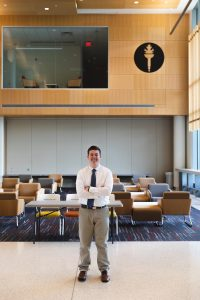 Rowan student Jason Brooks standing in the Rowan Business Hall