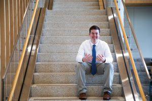 Rowan political science major Jason Brooks on the steps of Business Hall