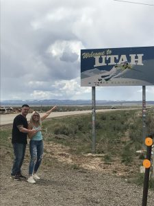 Rowan alumna Vanessa Vause and her dad stand at the entrance to the state of Utah