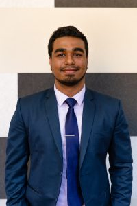 Ishmaqel a mechanical engineer in a navy blue suit
