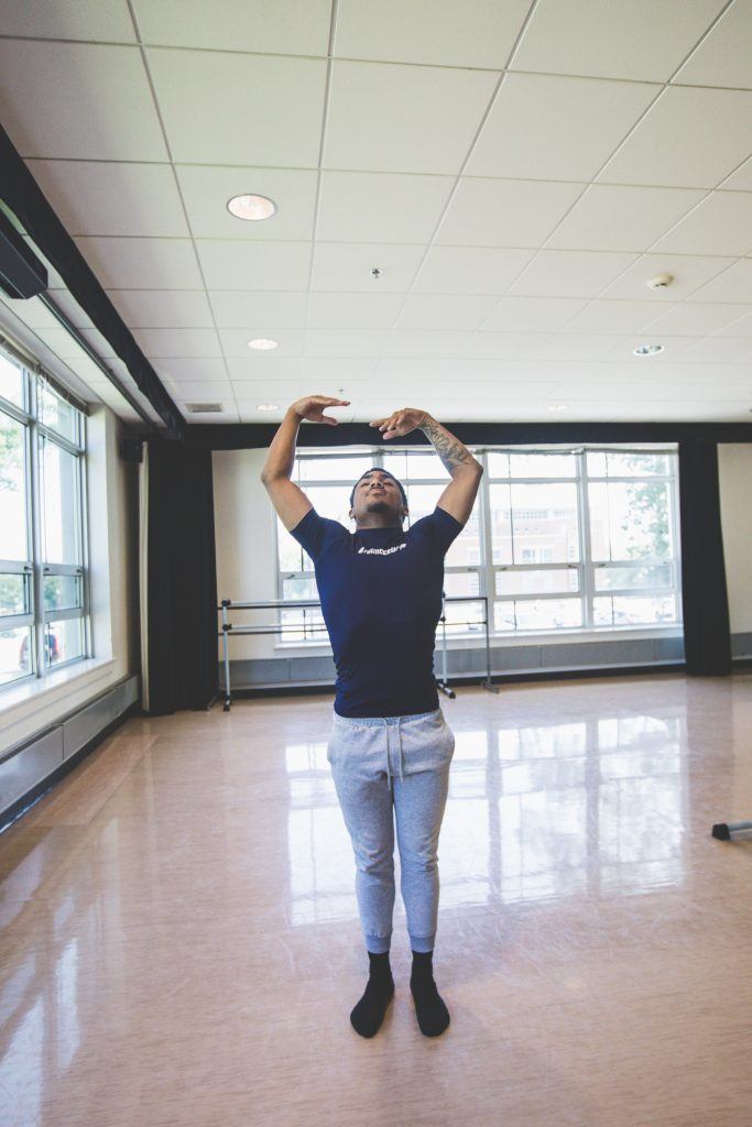 Rowan student Giovanni Rodriguez striking a dance pose in the dance studio