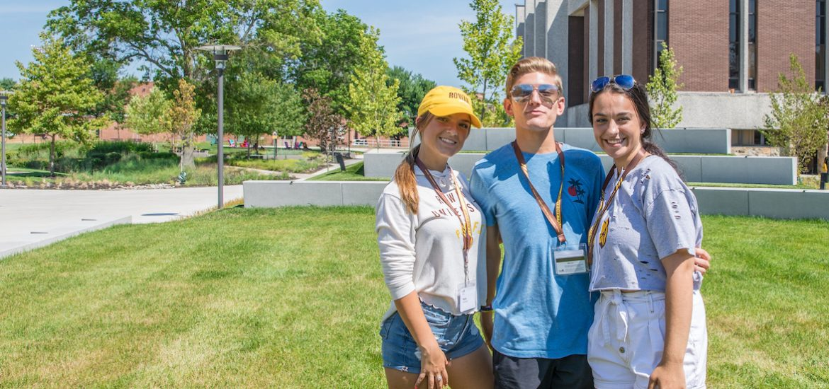 A group photo of three freshmen outside Wilson Hall