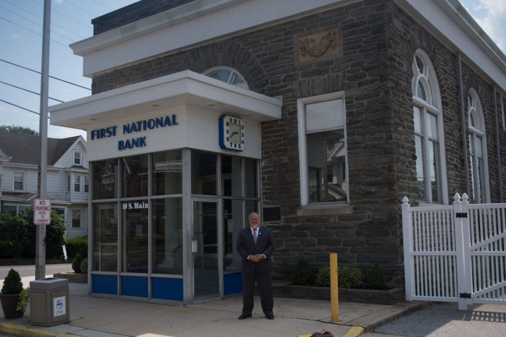 Alumnus Brian W. Jones outside of the First National Bank of Elmer, where he is President and CEO.