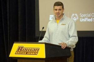 Rowan alumnus William Moylan speaks at a Unified Sports event