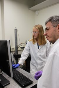 Translational biomedical science major Alyssa Sanders and a biophysics major in lab room