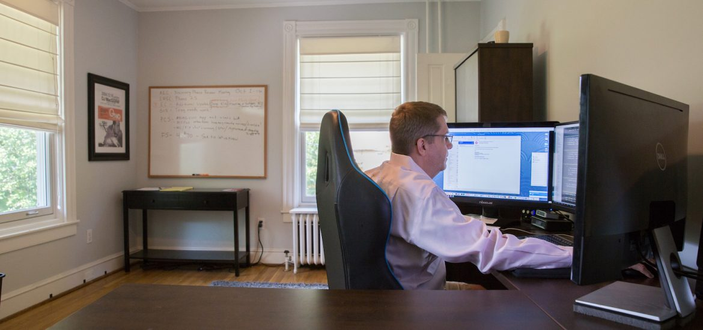 Steve McKeon working on his desktop computer in his home office