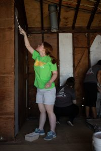 First-Year Volunteer Connection student leader Rose Dickmann helps out at the St. Bernard's disaster relief project.