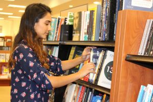 Amaal Khan looking through books at Barnes and Noble