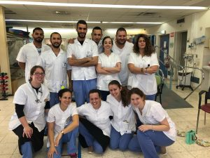 Rowan Biochemistry major Alyssa Salera (bottom row, second from right) in the Israel clinic