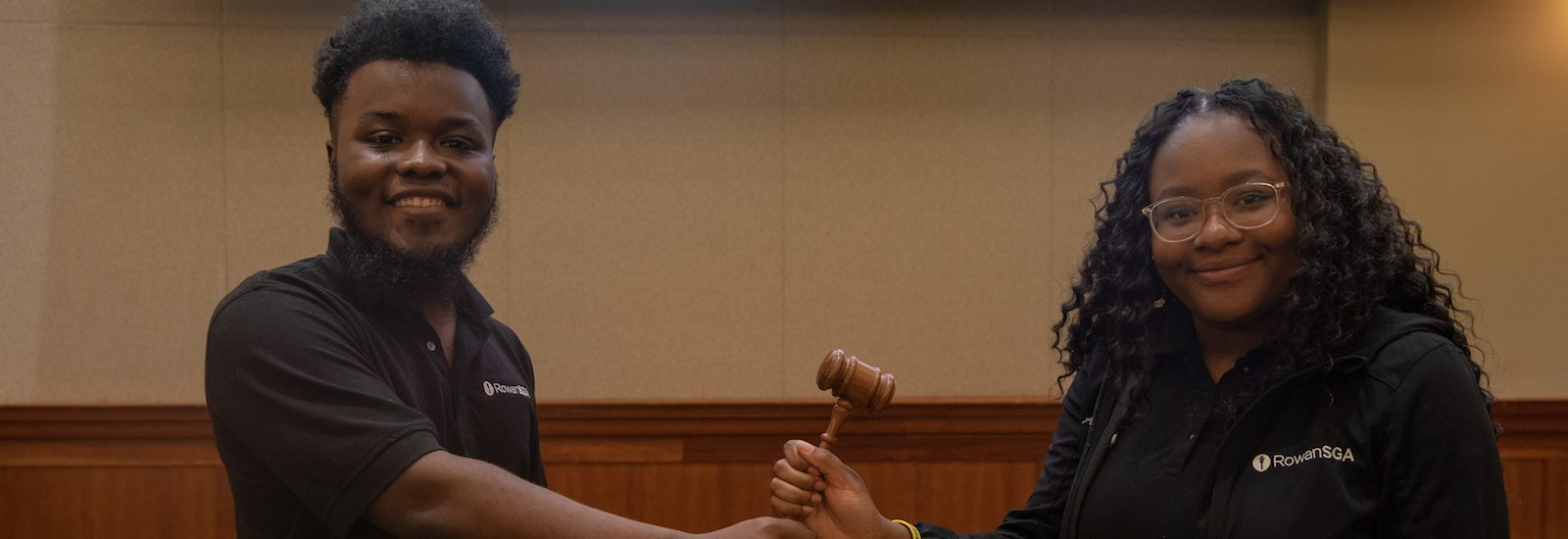 Arielle holds the student government association gavel.