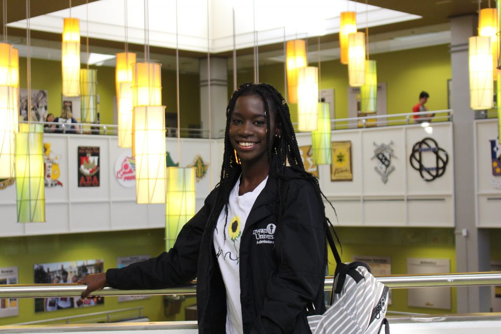 Mary Gomez, an international student and Community Health major, stands inside the Chamberlain Student Center