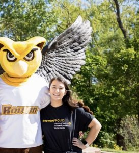 PR major and transfer student Jenna Fischer poses with WHOO RU at the owl statue