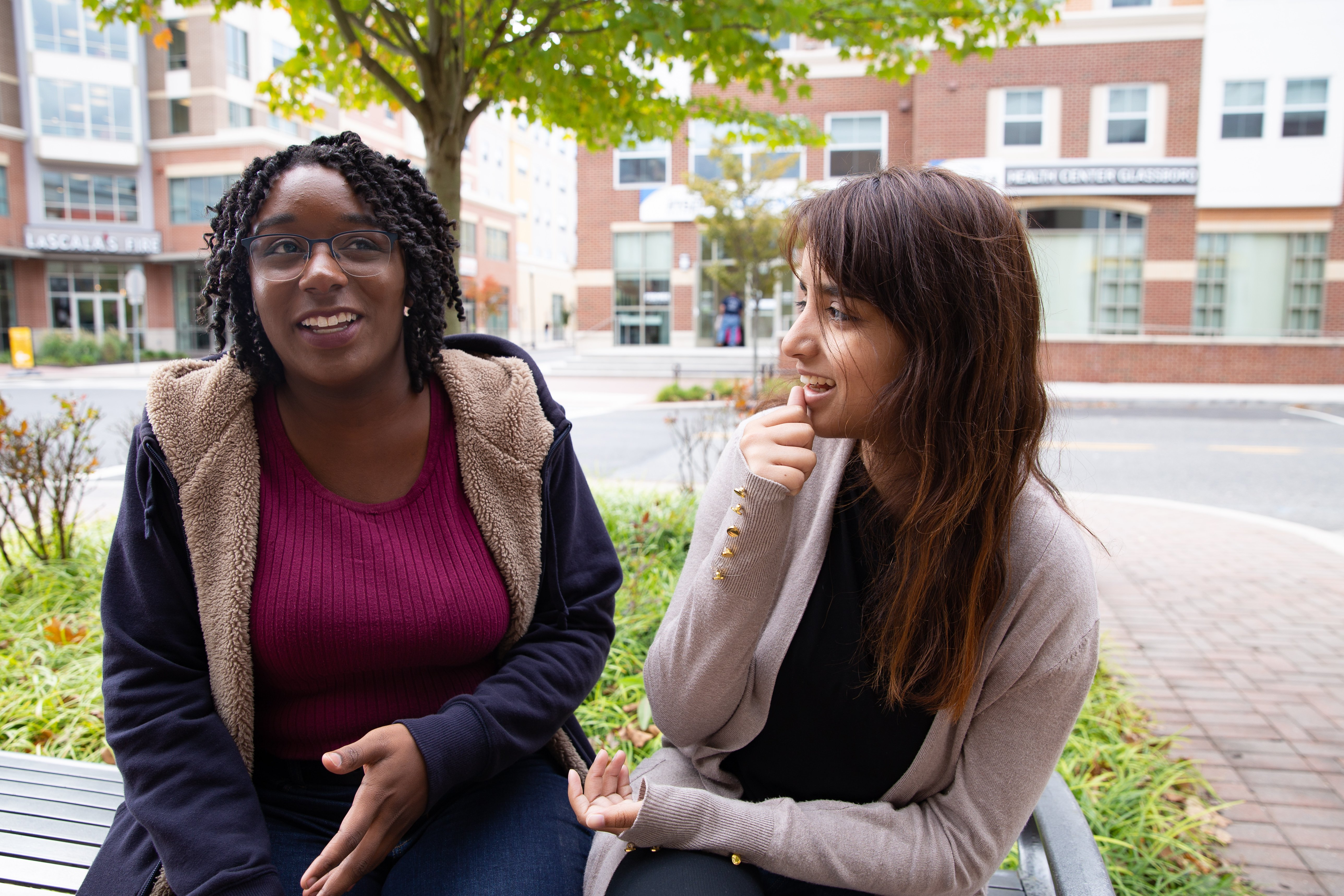 Higher Education Administration track graduate student Jessica Hassell (left) talks to another student on Rowan Boulevard.
