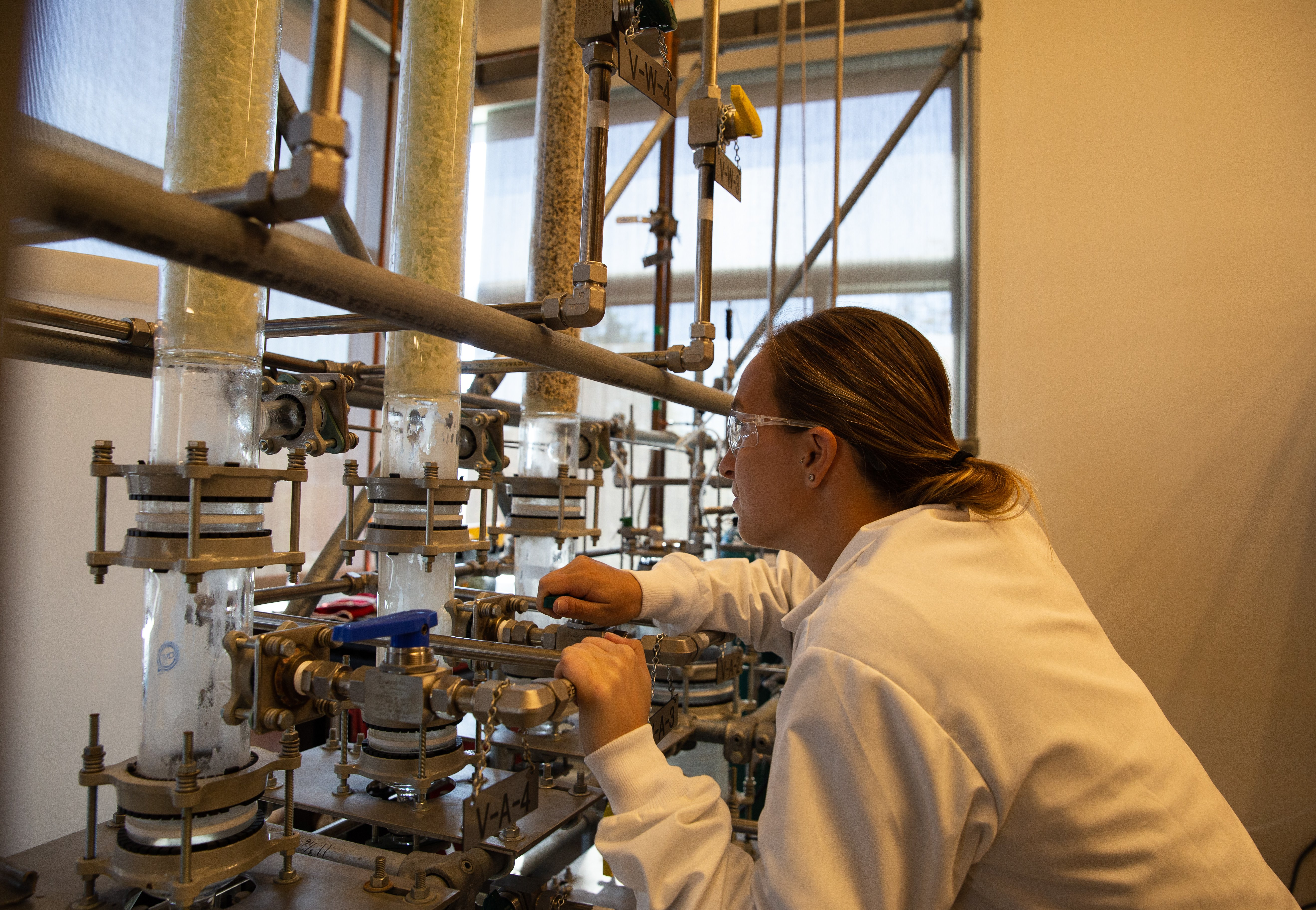 Rowan Chemical Engineering major Casey Wagner works in an engineering lab.
